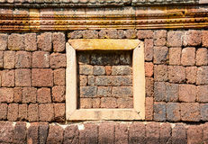 Window on laterite wall, Panomrung historical park Stock Images
