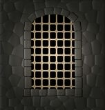Window and lattice. In the stone wall of a window in the form of an arch with a large lattice, illuminated from the outside Stock Photo