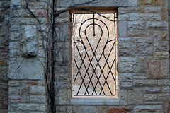 Window with a lattice. In the stone wall Royalty Free Stock Photos