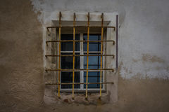 The window with lattice in wall of an old building Stock Photos