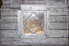 The window in the layout rhombus. In the village Royalty Free Stock Photos