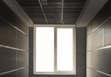 Window light at end of tunnel. Window, light at the end of a tunnel, conceptual and abstract Royalty Free Stock Photos