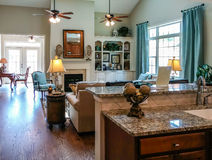 Window Light on Hardwood Floors and Granite Countertops. Beautiful new kitchen with hardwood floors and granite countertops Royalty Free Stock Photo