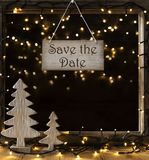 Window, Lights In Night, Text Save The Date. Sign With English Text Save The Date. Window Frame With Lights In The Night In Background. Christmas Decoration Like Stock Photography