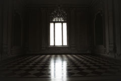 Window lit with mysterious white light in a spooky room built in. Baroque style Stock Image