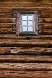 Window in a log wall Stock Photos