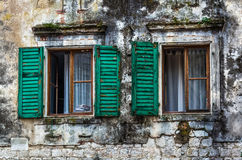 Window with louvers in old house Stock Photography