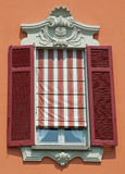 Ornamental Italian window with shutters Royalty Free Stock Photography