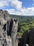 Rocky limestone over looking mountain ranges. Sharp rocky limestone over looking mountain ranges stock photos
