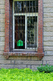 Window and mail box. Window with rail, and a small green mail box, shown as living environment, or missing and conmmunication Royalty Free Stock Image