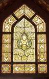 The window of the main chapel. The upper part of the ubosoth windows is also beautifully decorated with the stained-glass made in Florence , Italy but designed royalty free stock images