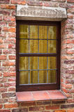 Window of a medieval building with old brick wall Royalty Free Stock Photo
