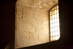 Window of a medieval church Stock Images