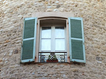 Window on medieval stone wall Stock Photo