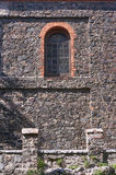 Window on medieval stone wall of the church Royalty Free Stock Image
