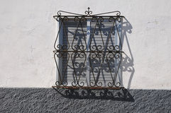 Window with metal grate Royalty Free Stock Images