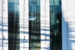 Window of modern architecture.Thailand. Building blue construction urban estate sky city apartment glass new town design tower view exterior white wall office stock photos