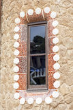 Window with mosaic ,gingerbread  house by Gaudi in Park Guell, Barcelona, Spain Royalty Free Stock Photography