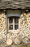 Window of mountain house with stone roof and firewood, Bulgaria Stock Photo