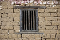 Window on mud brick wall. Ancient window on mud brick wall Royalty Free Stock Images