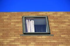 A window of a neighbor in the house opposite Stock Image