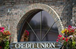 Free Window Of A Credit Union Surrounded By Flower Baskets Stock Photo - 123945250