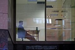 Office window. Business man sitting in office interior Royalty Free Stock Photos