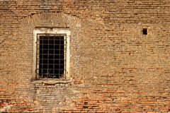 Window on old abandoned castle wall Stock Images
