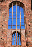 Window of an old abandoned church with brick wall Stock Photos