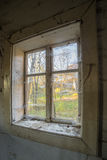 Window in old abandoned house Stock Images