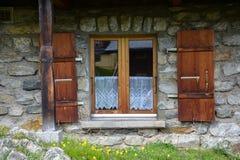 A window of an old alpine hut Stock Photo