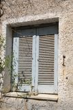Window of an old apartment building in Loutraki. Royalty Free Stock Photos