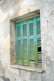 Window of an old apartment building in Malia. Stock Photo