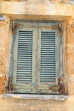 Window of an old apartment building in Malia. Royalty Free Stock Photography