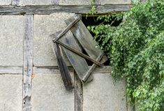 Old window hatch. Window of an old barn in the countryside Royalty Free Stock Image