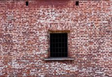 Window  in the old brick wall Stock Photo