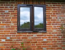 Window on Old Brick wall Stock Image
