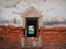 Window and old brick wall. In an abandoned church stock image