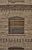 Window and the Old Brick Wall HDR 2. Old brick wall with a window, inside a old lumber mill that was made into a office buildung in Salt Lake city Utah USA Royalty Free Stock Photography