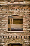 Window and the Old Brick Wall Painting. Old brick wall with a window, inside a old lumber mill that was made into a office buildung in Salt Lake city Utah USA Royalty Free Stock Photos