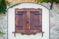 Window with old brown wooden shutters royalty free stock photography