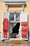 Window of an old building in Szentendre with exposed folk handicrafts Stock Photos
