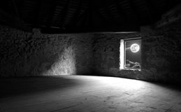 Window of the old castle. Full moon seen through the window Royalty Free Stock Images