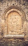 Window in an old church boarded up with stone bricks. Texture ba Stock Image