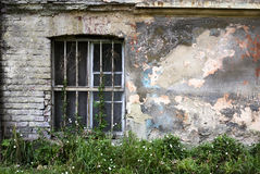 Window on an old concrete wall. Grunge background Stock Photo