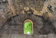 Window in the old crypt. Window with a lattice in an old crypt Royalty Free Stock Photo
