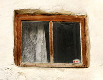Window of old house. Window shade and cup on a window-sill Stock Photo