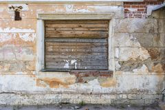 The window in the old house boarded up.  stock photo