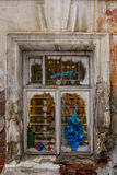 Window in an old house, brick walls with crumbling plaster Royalty Free Stock Image