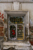 Window in an old house, brick walls with crumbling plaster Royalty Free Stock Photography